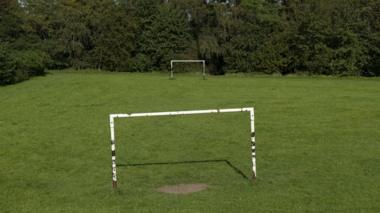 Goalposts in a field