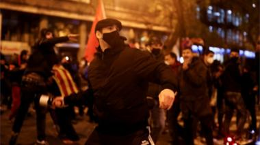 People throw objects during a protest against rapper Pablo Hasel's arrest