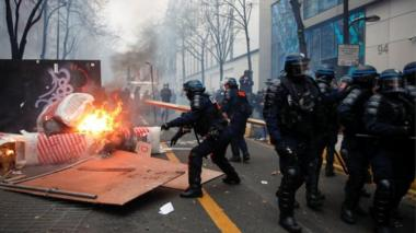 "Police officers remove a barricade during a demonstration against the ""Global Security Bill"""", that right groups say would make it a crime to circulate an image of a police officer""s face and would infringe journalists"" freedom in the country, in Paris, France, on 5 December 2020."