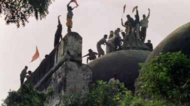 In this file photograph taken on December 6, 1992 Hindu youths clamour atop the 16th century Muslim Babri Mosque five hours before the structure was demolished by hundreds supporting Hindu fundamentalist activists.