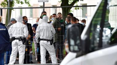 Police outside a German tower block enforcing a coronavirus quarantine