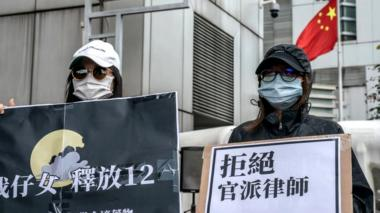 Family members of the Hong Kong residents detained in China protest outside the Liaison Office of the Central People's Government, 30 September 2020 in Hong Kong, China