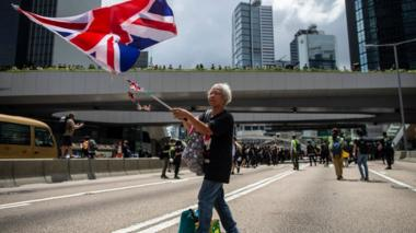 A woman holds a UK flag during a protest in Hong Kong in 2019