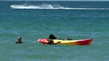 President Marcelo Rebelo de Sousa helps two women in the water