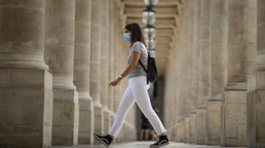woman walks in paris