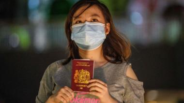 A woman in Hong Kong with her British National Overseas passport