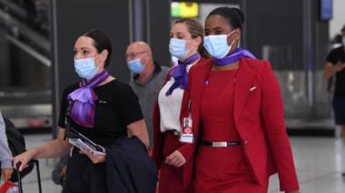 Virgin Australia flight crew is seen in a baggage collection area at Tullamarine Airport in Melbourne, Australia, 08 January 2021.