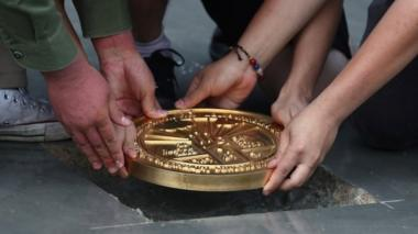 "Student leaders install a plaque declaring: ""This country belongs to the people"""