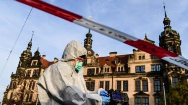A Police Forensics officer investigates the area near the Dresden museum