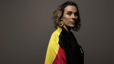Laura Thompson wearing an Aboriginal flag draped around her shoulders