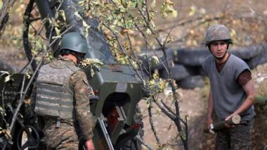 A picture provided by the Armenian Defence Ministry Press Office via PAN Photo shows Armenian soldiers fire during military combat with the Azerbaijani army in the Nagorno-Karabakh Republic