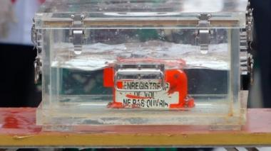 One of the Flight SJ182's two black boxes retrieved from the crash site. Photo: 12 January 2021