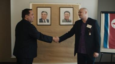 Alejandro Cao de Benós and Ulrich Larsen shaking hands at a KFA meeting in Germany
