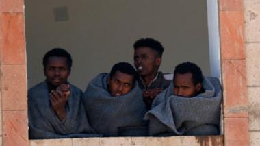 Ethiopian migrants are seen inside a building while undergoing quarantine as they across Yemen's land to reach Saudi Arabia