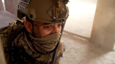 Afghan police officer in training exercise