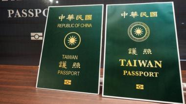 Taiwan unveils its new passport, right, which has the word Taiwan larger and the words Republic of China smaller