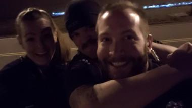 Former Aurora Police Department officers Erica Marrero, Jaron Jones and Kyle Dittrich re-enact a chokehold near a memorial to Elijah McClain, in Aurora, Colorado, in October 2019.