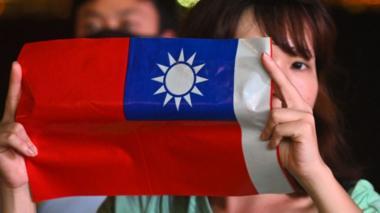 A woman holds a Taiwanese flag