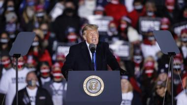 US President Donald J. Trump speaks at a campaign rally at the Waukesha County Airport in Waukesha, Wisconsin, USA, 24 October 2020