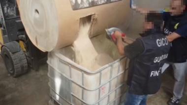 Italian police inspect tubs containing counterfeit Captagon pills
