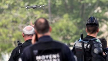 French gendarmes test a drone near the Arc de Triomphe, in the French capital, prior to the start of May Day demonstrations, in Paris on May 1, 2019