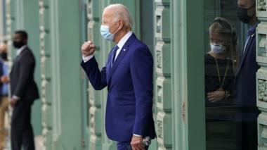 U.S. Democratic presidential candidate Joe Biden pumps his fist to supporters as he walks to his motorcade vehicle in downtown Wilmington, Delaware, U.S., October 23, 2020