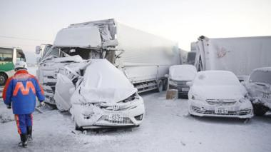 Vehicles are left damaged after the pile-up in Japan