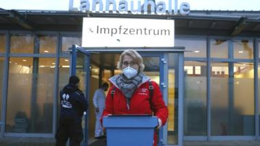 A worker with Covid vaccines sets out to inoculate patients in Dillenberg, Germany