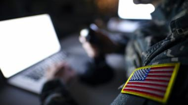 Stock photo of a solider at a laptop
