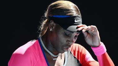Serena Williams reacts to defeat
