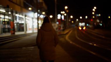 lone woman walking by tram tracks
