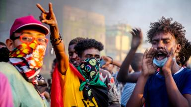 Sudanese protesters chant near by burning tires during a demonstration in the capital Khartoum, Sudan - Tuesday 26 October 2021