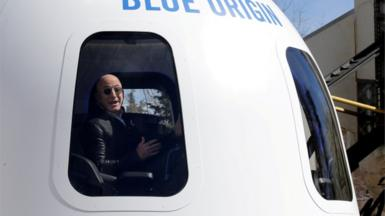 Bezos speaks in 2017 from on board a spaceship built by his company Blue Origin