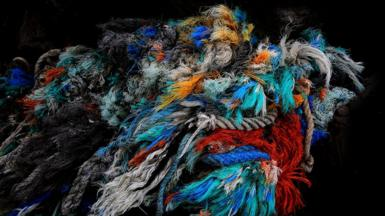 A collection of frayed multi-coloured ropes