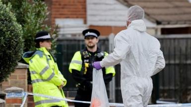 A man in a forensics suit