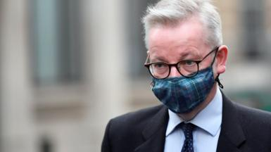 Michael Gove in a tartan mask