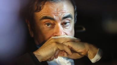 Carlos Ghosn sits in a car after leaving his lawyers office in Tokyo, Japan, 6 March 2019