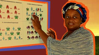 Thembi standing by a board with HIV symbols