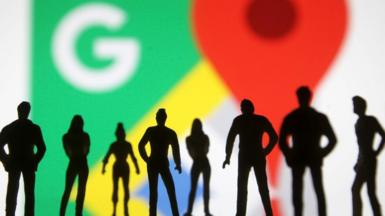 Google Maps logo with silhouettes