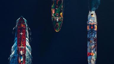 Three commercial ships from above