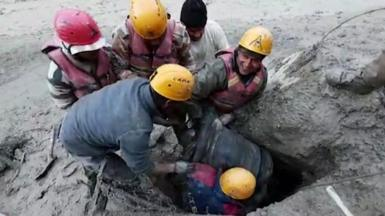 Emergency workers rescue the man from a tunnel