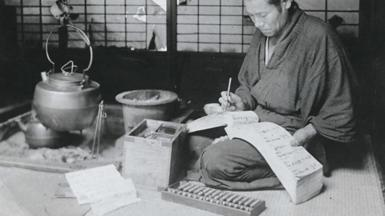 Japanese man with abacus