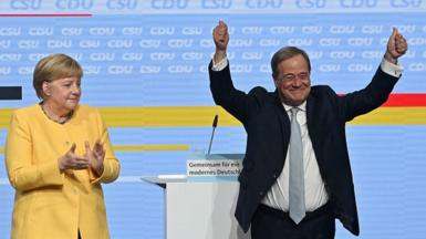 German Chancellor Angela Merkel (L) and Armin Laschet (R), leader of Germany's conservative Christian Democratic Union (CDU) party