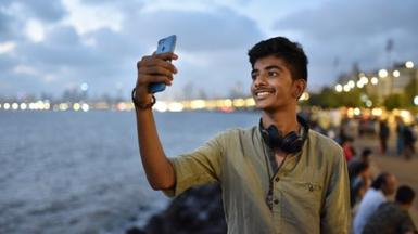 Indian man with mobile phone