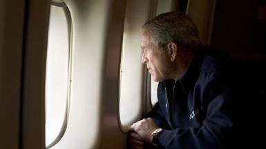 Former US President Bush looking out of a window as Air Force One flew over the Hurricane Katrina-devastated New Orleans