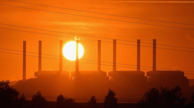 Sun setting over Hazelwood coal station in Australian state of Victoria in 2017