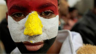 Man with face painted the colours of the Egyptian flag