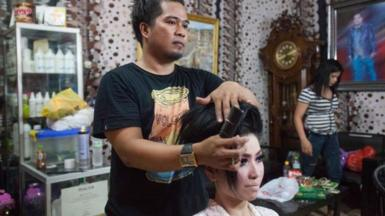 Born into a male body but taking on female gender roles, calabai often work in beauty salons or as wedding planners