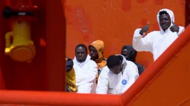 Migrants on board the tug boat