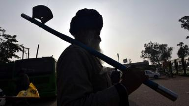 A 80 Year Old farmer arrive for enter in the capital for Tractor Republic Day parade rally during their farmers' ongoing agitation over the new farm laws, at Singhu border on January 25, 2021 in New Delhi, India.